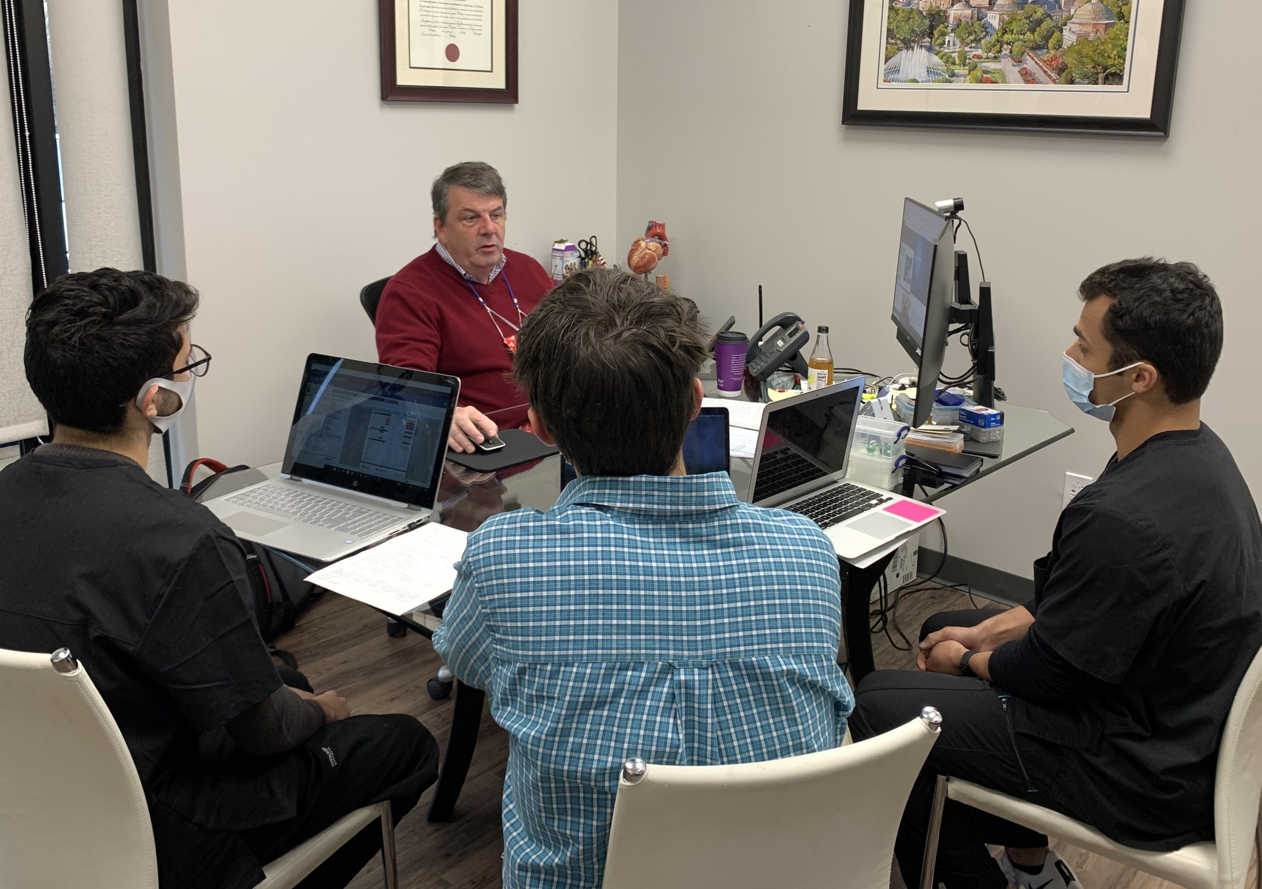 Interns Meeting with Dr. Chronos